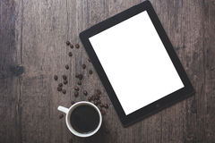 Coffee cup and Ipad. With a white screen Stock Images