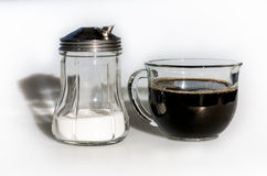 Coffee cup and jar of sugar Royalty Free Stock Image