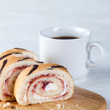 Coffee cup and jelly rolls Royalty Free Stock Image