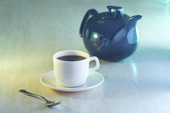 Coffee cup and kettle on table Stock Image