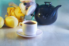 Coffee cup and kettle with toy Stock Photo