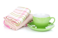 Coffee cup and kitchen towels Stock Images