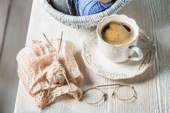 Coffee cup and knitted scarf and color skein. On white table Stock Photography