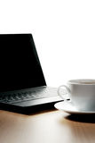 Coffee cup and laptop Stock Image
