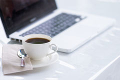 Coffee cup and laptop for business Stock Images