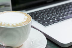 Coffee cup and laptop business Stock Photos