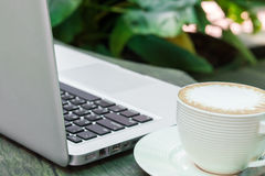 Coffee cup and laptop business Stock Image