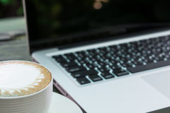Coffee cup and laptop business Royalty Free Stock Image