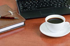 Coffee cup and laptop computer Royalty Free Stock Images
