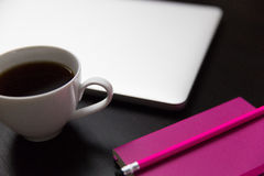 Coffee cup and laptop computer. Office workspace with coffee cup royalty free stock photo
