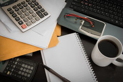 Coffee cup, laptop, Document file , pen , Calculator , notepad a Royalty Free Stock Photo