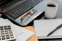 Coffee cup, laptop, Document file , pen , Calculator , notepad a Stock Photos