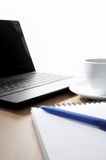 Coffee cup, laptop and notebook Royalty Free Stock Photography