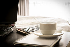 Coffee cup with laptop and notebook and Calculator Royalty Free Stock Images