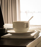 Coffee cup with laptop and notebook Royalty Free Stock Images