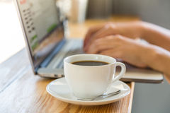 Coffee cup  with laptop on old wooden Royalty Free Stock Photos