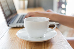 Coffee cup  with laptop on old wooden Royalty Free Stock Image