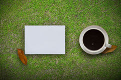 Coffee cup,laptop and paper note in green background.Top view with copy space. Stock Photo