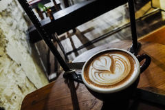 Coffee cup with latte art  in cafe Royalty Free Stock Photos