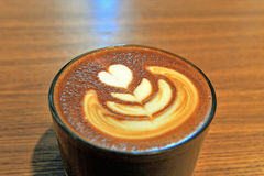 Coffee cup with latte art Stock Images