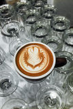 Coffee cup with latte art Rosetta pattern Stock Image