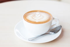 Coffee cup with latte art Royalty Free Stock Image