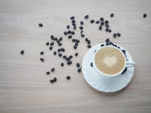 Coffee cup of latte coffee with heart shape sign and Coffee bean Royalty Free Stock Photography