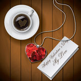 Coffee cup with Letter with pendant on wood background.  Stock Photos