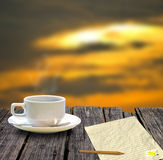 Coffee cup and letter with sunset sky Stock Image