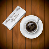 Coffee cup with letter on wood background.  Royalty Free Stock Image