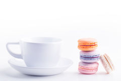 Coffee cup and macarons Stock Photo