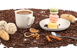 Coffee cup with macaroon and beans on a white background. Royalty Free Stock Photography