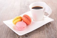 Coffee cup and macaroon Stock Photo