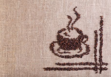 Coffee cup made of beans. On burlap - with copy space Stock Photos