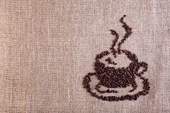Coffee cup made of beans on burlap background Stock Photo