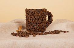 Coffee cup made of beans Stock Photos