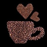 Coffee cup made of coffee beans. On black background Royalty Free Stock Photo