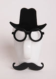 Coffee cup in mans image. Hipster style, glasses, mustache, hat Stock Photo