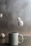 Coffee cup with marshmallows on a dark background, abstraction Stock Images