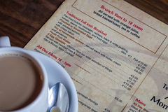 Coffee cup on menu Royalty Free Stock Photography