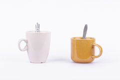 Coffee cup and milk cup and spoon on break time in white background isolated Royalty Free Stock Image