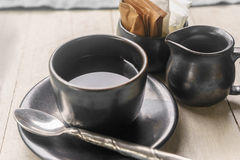 Coffee cup and milk cup with sugar and cream pack Stock Image