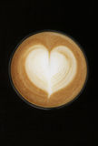 Coffee cup with milk and heart shape. Brown color Royalty Free Stock Images