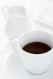 Coffee Cup with Milk Jug Stock Images
