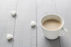 Coffee cup milk sugar cubes scattered Stock Images