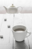 Coffee cup milk sugar cubes scattered Stock Photos