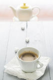 Coffee cup milk sugar cubes scattered Royalty Free Stock Photos
