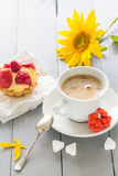 Coffee cup milk sweet dessert cake strawberries sunflower rowan Stock Photography