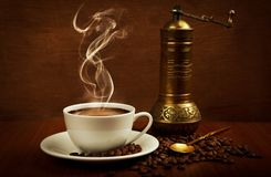 Coffee cup and mill stock photos
