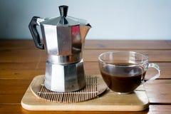 Coffee cup and moka pot. Hot espresso and moka pot royalty free stock photos